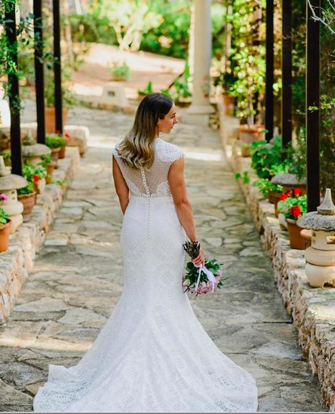 ibiza bride at destination wedding with natural wedding hair loose waves and lace wedding dress