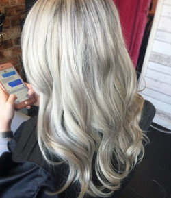 white blonde hair with silver tones created in professional hair salon