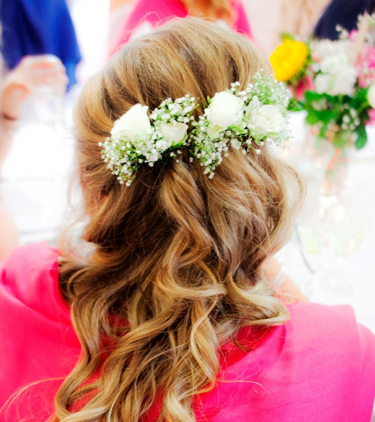 loose curly bridal hair with floral headwear adding detail and natural look