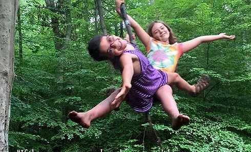 Children Swinging at Nature Camps Inc.