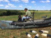 Paul Botelho running Gunner out of the canoe