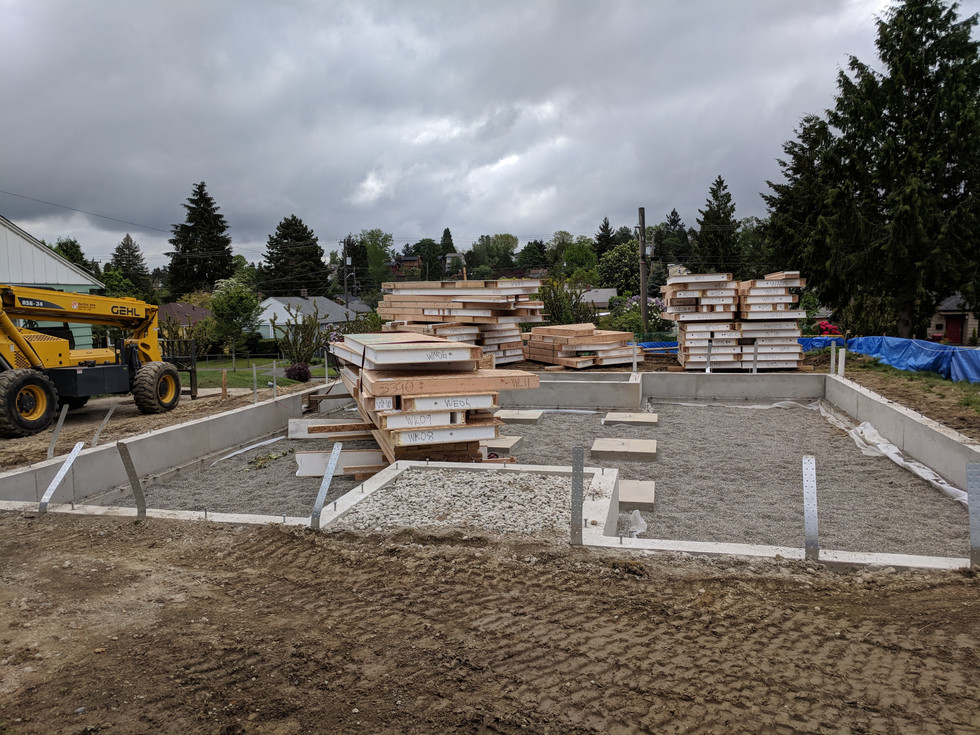 Foundation laid, and SIPs panels arrived.