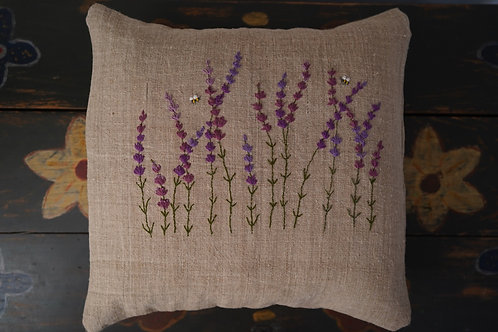 Hand embroidered cushion cover with lavender flowers.
