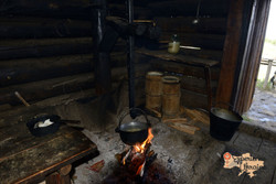 Cooking over open fire in cabin LR-imp