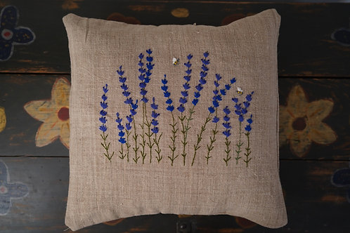 Hand embroidered cushion cover on antique linen