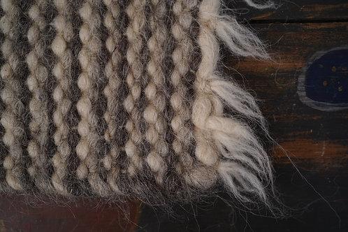 Hand wowed wool seat pad