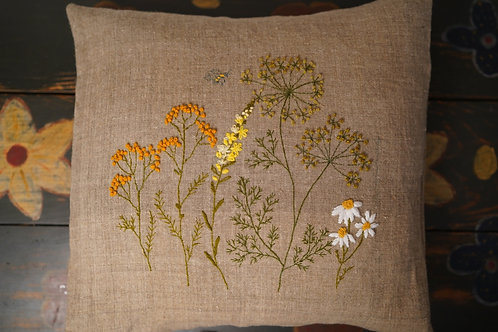 Hand embroidered cushion cover on antique linen.