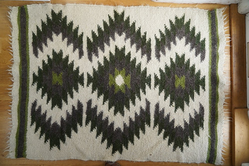Handwoven wool rug. Only one available