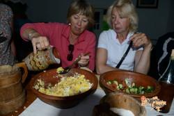 Morren and Christina preparing food-imp