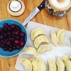 Making dumplings with cherries