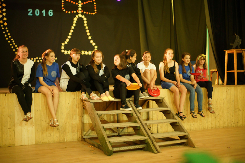 Youth theatre group are resting after performance.