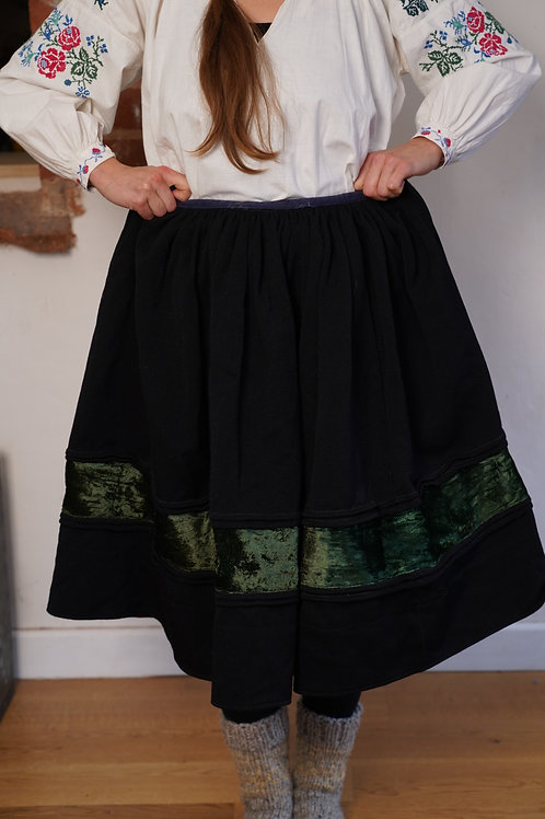 Vintage black skirt with green velvet stripe