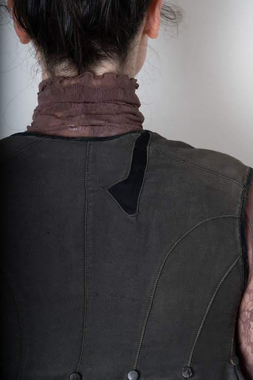 Grey waistcoat with visible repair