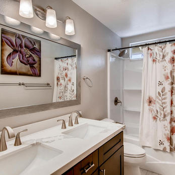 Hall Bath with Brushed Nickel Finishes.