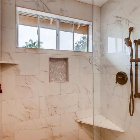 Master Bathroom Frameless Shower Door and Shower Wand.