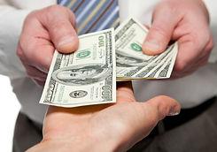 Human hands exchanging money - closeup s