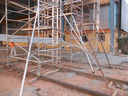 Using Scaffolds for roofing work with wheels in rails for fast movement 2