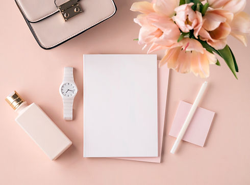 Flat lay scene in peach pink tones for s