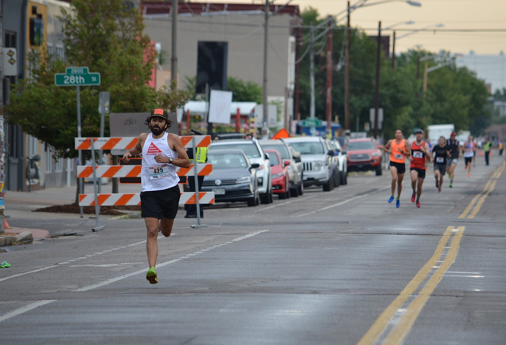 Jess Rojas finishes the Rino 5K on July 29th, 2017 in Denver, CO