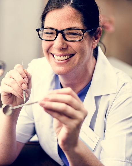 dentist-with-her-patient-PRUA2W7.jpg