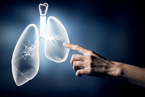 Close up of hand touching lungs sign.jpg