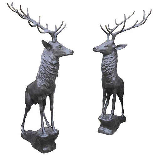Pair of Bronze Life 20th Century Size Stags on Rocks in a Majestic Pose