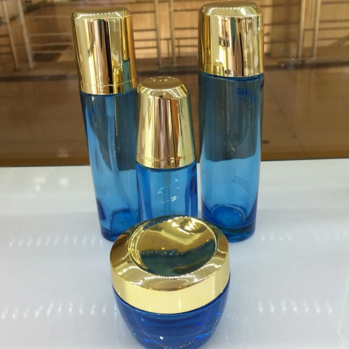 Skincare blue glass jar and bottle set
