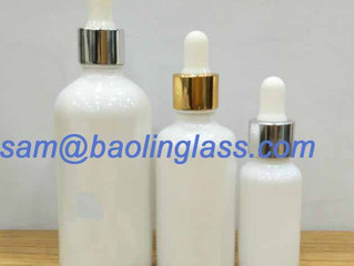 White glass bottles with dropper for skin essence oil or hair oils