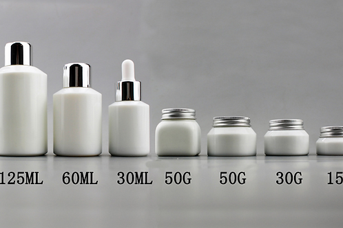 White ceramics cosmetic jar and bottles