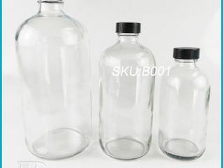 Glass Standard Boston Round Bottle with Black Phenolic Closure