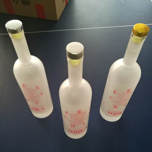 750ml vodka or rum or wine frosted glass bottle with cork cap