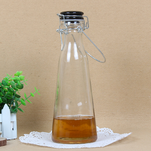 Empty glass milk bottles with wire hood swing top
