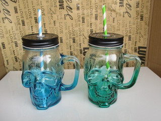 colorful skull shape glass bottle