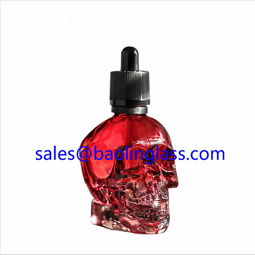 Wholesale 60ml skull shape empty glass perfume bottle