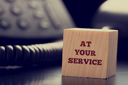At Your Service written on a wooden cube