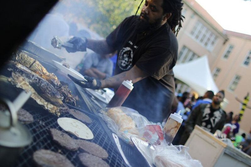 Food vendors along Opelousas Avenue in front of Martin Behrman Charter School fired up food for the Poetry on the Avenue event. (Photo by Nathaniel Colins, Jr.)