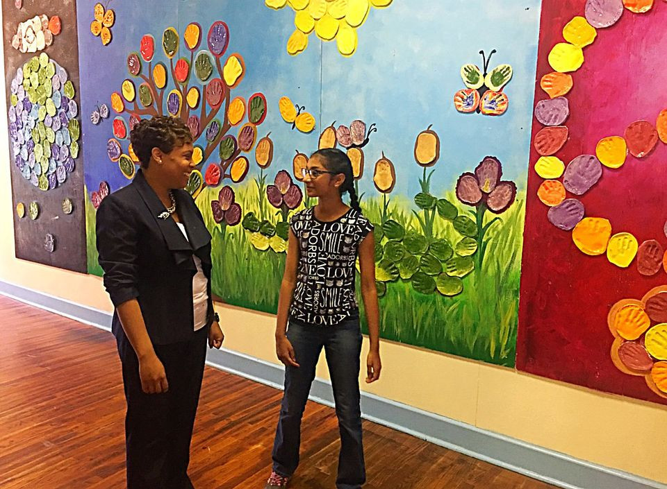 Gretna No. 2 Academy for Advanced Studies Principal Tamara Warner walks in the school halls with 5th grader Srija Tamidela. (Photo by Brandon Armant)
