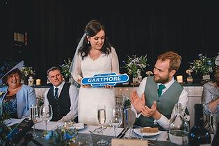 bride giving groom a Gartmore plaque wdding present