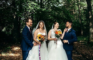 two happy couples, outdoor at a double wedding