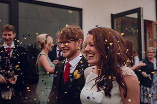 newly weds under confetti