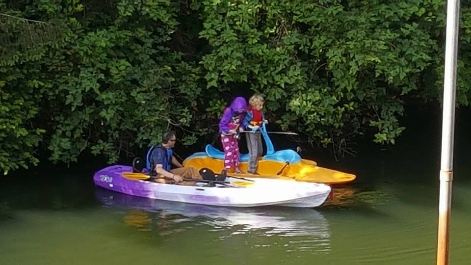 kids in pedal boat, man in kayak