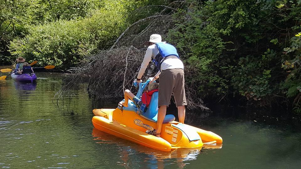 family kayaking Siltcoos River Canoe Trail