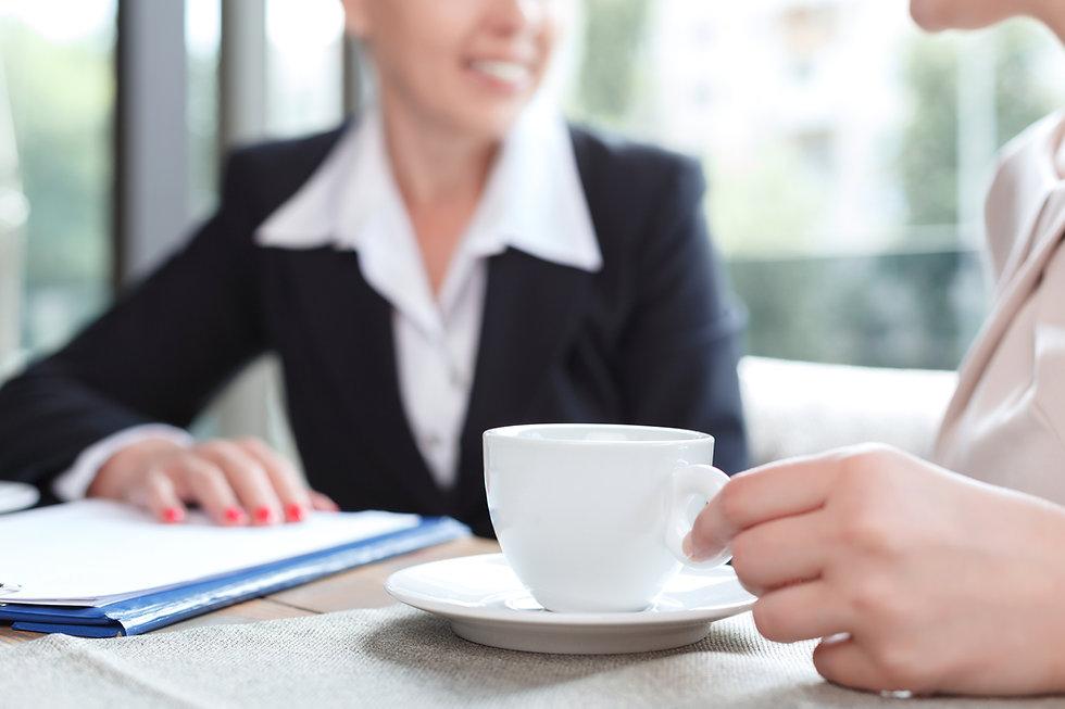 Businesswomen during a business lunch.jp