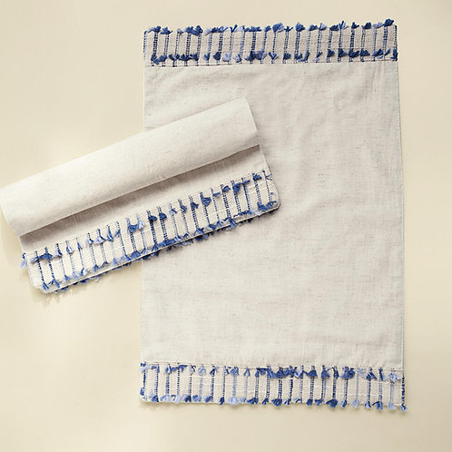 two placemats with blue tassels