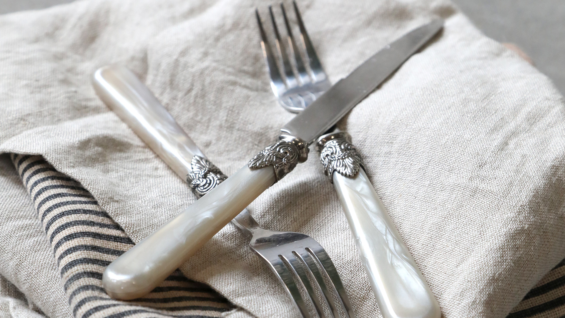 napkins with silver cutlery.jpg