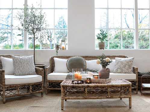 wicker sofa with cushions