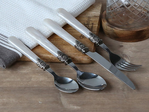 cutlery set with mother of pearl colour handles and silver decoration