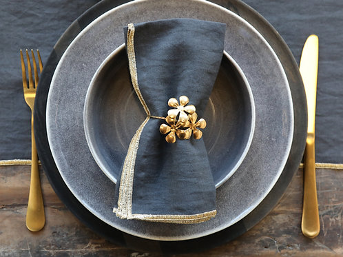 table setting with gold flower napkin ring