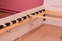 lifting mechanism on the housing bed,assembly of the bed in the bedroom, white bed assembl