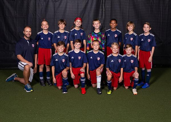 08 United FC Strikers Navy.jpg
